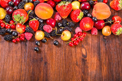 Fresh berries on wooden table Stock Photography