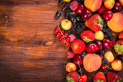 Fresh berries on wooden table Stock Images