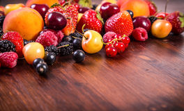 Fresh berries on wooden table Royalty Free Stock Images