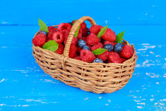 Fresh berries on a wooden table Stock Images