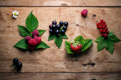 Fresh berries on wooden table Stock Image