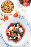 Fresh berries, yogurt and muesli for breakfast, top view Stock Photos
