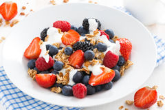 Fresh berries, yogurt and muesli, top view. Close-up Stock Photos