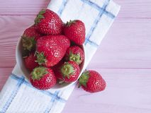 Fresh berry closeup organic design strawberry natural health harvest summer dish towel on a pink wooden background. Fresh strawberry berry organic dish towel on royalty free stock images