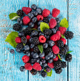 Fresh berry fruit pile placed on old wooden planks Stock Photos