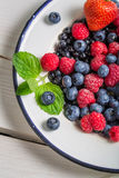 Fresh berry fruits with milk Stock Photo