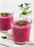 Fresh berry smoothie, milkshake, yogurt, dessert decorated grated chocolate and mint Stock Photography