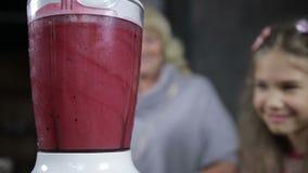 Fresh berry smoothie preparation in blender stock video