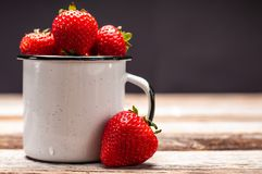 Fresh berry. Strawberries in the cup on wooden table stock photos