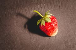 Fresh berry of strawberry on black table/ Strawberry. Fresh berry of strawberry on black table closeup. Fresh berry of strawberry on black table/Strawberry stock photo