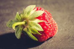 Fresh berry of strawberry on black table/Strawberry. Fresh berry of strawberry on black table. Closeup. Fresh berry of strawberry on black table/ Strawberry royalty free stock images