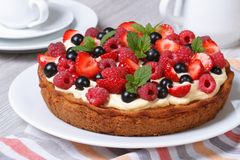 Fresh berry tart with strawberries, raspberries and mint closeup Stock Image