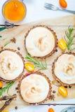 Fresh Berry Tartlets filled with Lemon Curd, Kumquat Jam, Berries and Meringue, Delicious Dessert Stock Image