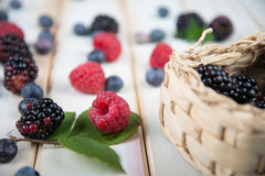 Fresh berrys fruit in basket on wooden table Royalty Free Stock Photography