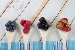 Fresh berrys fruit on wooden spoon Stock Photos