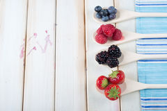 Fresh berrys fruit on wooden spoon Stock Images