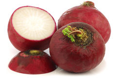 Fresh big red radishes and a cut one. On a white background Royalty Free Stock Photography