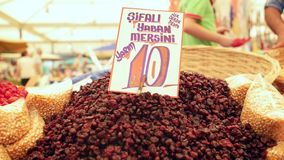 Fresh bilberries on market at the biggest and most crowded bazaar in the city. Located in Bostanli, Karsiyaka. IZMIR - JULY 2015: Fresh bilberries on market at stock video footage