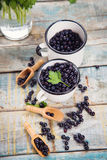 Fresh bilberry in cup Royalty Free Stock Images