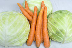 Fresh bio cabbage and carrots. Fresh bio cabbages  and carrots Royalty Free Stock Images