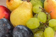 Fresh bio grapes, plums, pears and nectarine Royalty Free Stock Photo