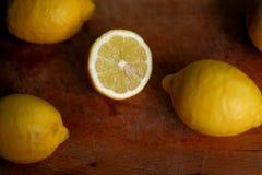 Fresh bio lemons on wood royalty free stock photo