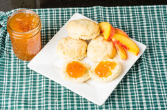Fresh biscuits with peach jam Royalty Free Stock Photography