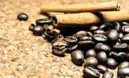 Fresh black coffe beans on cork table stock photo