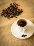 Fresh black coffee and beans Stock Image