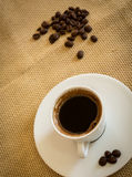 Fresh black coffee and beans Stock Images