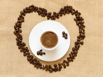 Fresh black coffee and beans Royalty Free Stock Images