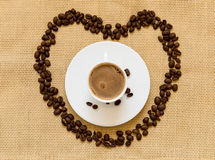Fresh black coffee and beans Royalty Free Stock Photo