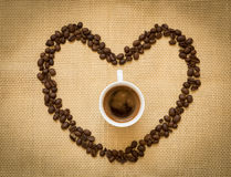Fresh black coffee and beans Royalty Free Stock Photography
