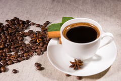 Fresh black coffee in mug on white plate on canvas Stock Photo