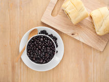 Fresh black coffee in a white cup of coffee with bread cut Stock Images