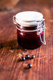 Fresh black currant, blackberry and black raspberry jam or marmalade in a jar on a wooden table Royalty Free Stock Image