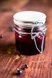 Fresh black currant, blackberry and black raspberry jam or marmalade in a jar on a wooden table Stock Photos