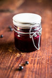 Fresh black currant, blackberry and black raspberry jam or marmalade in a jar on a wooden table Stock Photography
