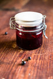 Fresh black currant, blackberry and black raspberry jam or marmalade in a jar on a wooden table Royalty Free Stock Photography