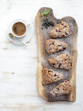 Fresh black-currant scones with cup of coffee Royalty Free Stock Image