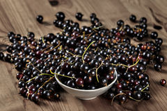 Fresh Black Currant on Wooden Table. Background Royalty Free Stock Images