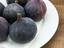 Fresh black figs age paintings, fresh fig fruit in dish, Royalty Free Stock Photography