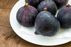 Fresh black figs age paintings, fresh fig fruit in dish, Royalty Free Stock Photo