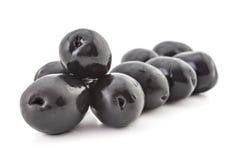 Fresh black olives. Heap of fresh raw black olives, isolated on white background Royalty Free Stock Photography
