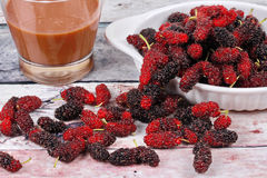 Fresh black and red ripe mulberries served with coffee. Stock Photo