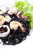 Fresh black tagliolini pasta with seafood in herbs Royalty Free Stock Images