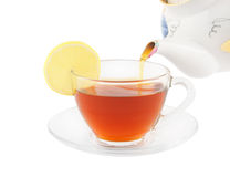 Fresh black tea pouring isolated Royalty Free Stock Image