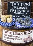 Fresh black and white expensive truffles. Fresh black and white expensive truffles exposed on shop, Italy Royalty Free Stock Image