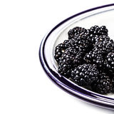 Fresh Blackberries in a bowl isolated on white Stock Images