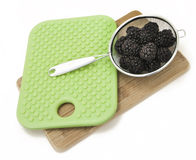 Fresh Blackberries with Green Cutting Board Stock Images
